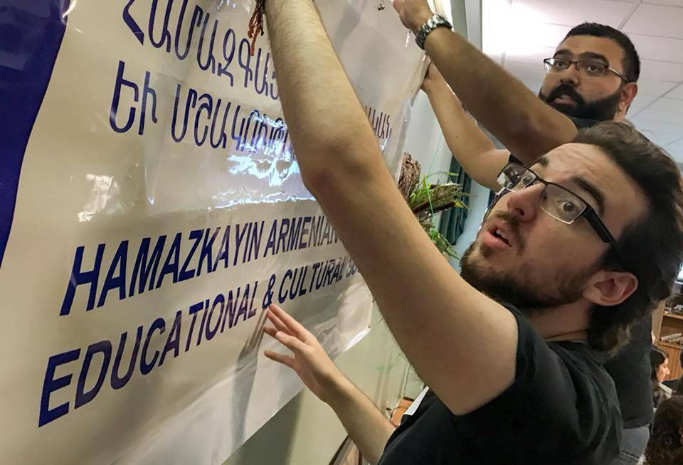 Participants from Montreal and Detroit set up the Hamazkayin banner at ArtLinks 2018. (Photo: Matthew Karanian)
