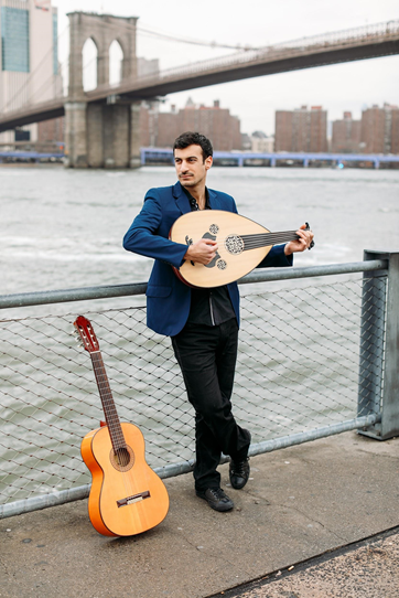 "The writer, performer, and musical mastermind behind ""Critical Distance"": Raffi Joe Wartanian, with an oud in his arms and guitar by his side.(Photo: Anastasia Italyanskaya)"
