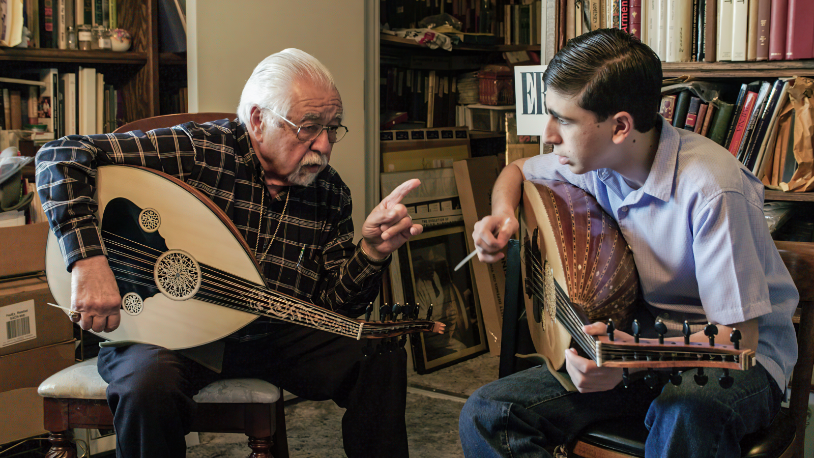 Famous oud player Richard Hagopian teaches his grandson, Andrew how to play an Armenian folk song (Photo courtesy of Stephanie Ayanian)