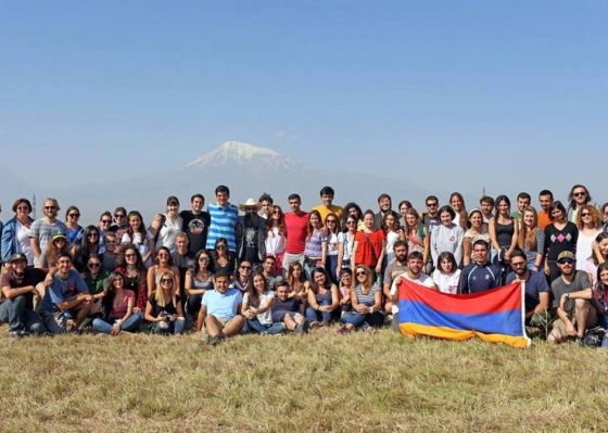 A group of Birthright Armenia volunteers pose in front of Mount Ararat.